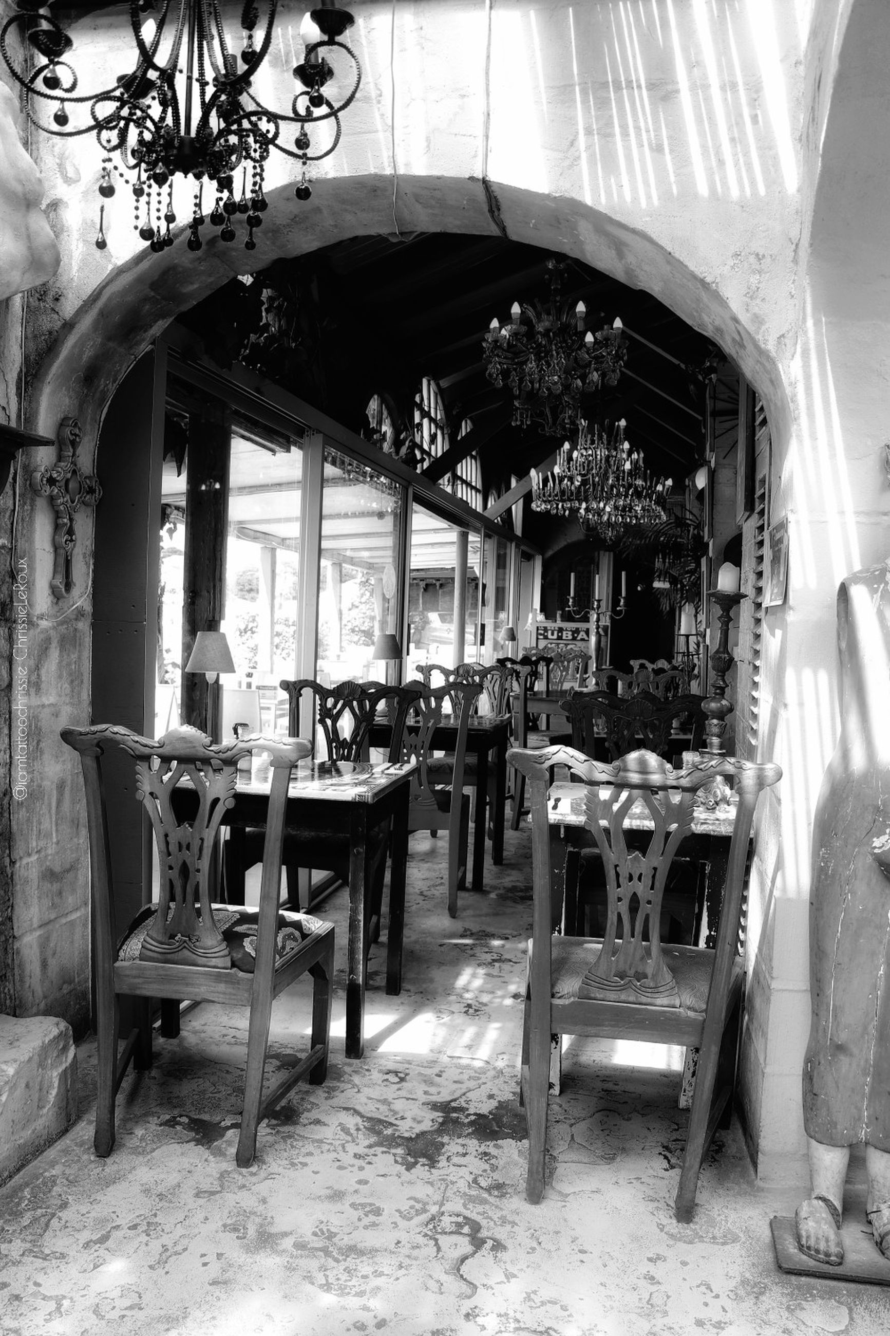 seat, table, chair, business, restaurant, architecture, indoors, food and drink, furniture, cafe, built structure, incidental people, day, illuminated, building, food, bar - drink establishment, place setting, setting, antique, dining