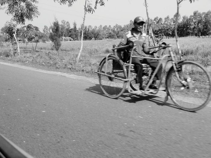 Blurred Motion Taking Photos Tricycle Tricycle With One Handle Outdoors On The Move In The Moment On The Road Black And White Black & White Race For Life Race With Him Single Handle Tricycle Cycle Paddling By One Hand Handicapped Handicapped Men My Commute
