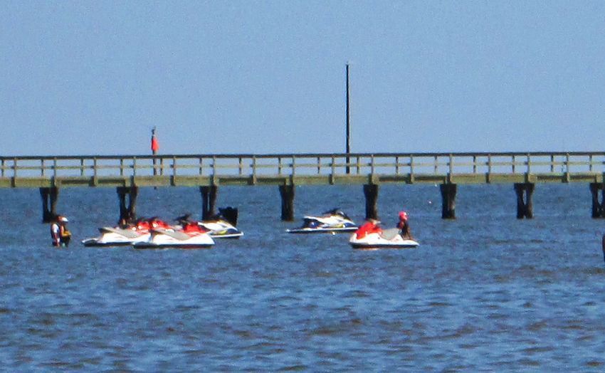 Beach hopping at Gulfport Mississippi. Blue Sea Gulfport Mississippi USA Vacation Time Beauty In Nature Beauty In Nature Bridge - Man Made Structure Bridge In The Sea Clear Blue Sky And Sea Clear Sky Jet Skiing Large Group Of People Leisure Activity Leisure Time Mode Of Transport Nature Nautical Vessel Ocean Outdoors People Real People Sea Sport Sports Race Water Wharf