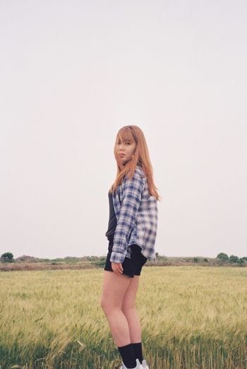 Field Smiling Nature Real People Standing Landscape Clear Sky Happiness Grass Copy Space Young Women Leisure Activity One Person Mid Adult Women Long Hair Lifestyles Young Adult Casual Clothing Looking At Camera Agriculture Film Photography Film Day Outdoors JEJU ISLAND  EyeEm Selects EyeEmNewHere