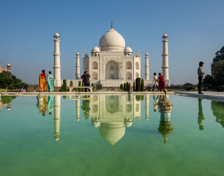 Taj Mahal Travel Travel Photography Architectural Column Architecture Building Exterior Built Structure Clear Sky Day Dome History Incidental People Large Group Of People Outdoors People Real People Reflecting Pool Reflection Sky Standing Water Symmetry Tourism Travel Destinations Water Waterfront