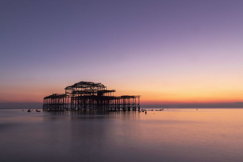 Ruins Brighton Pier Brighton Beach Sky Water Sea Architecture Sunset Built Structure Tranquility Scenics - Nature Beauty In Nature Tranquil Scene Waterfront Nature Horizon Over Water No People Horizon Pier Orange Color Dusk Outdoors