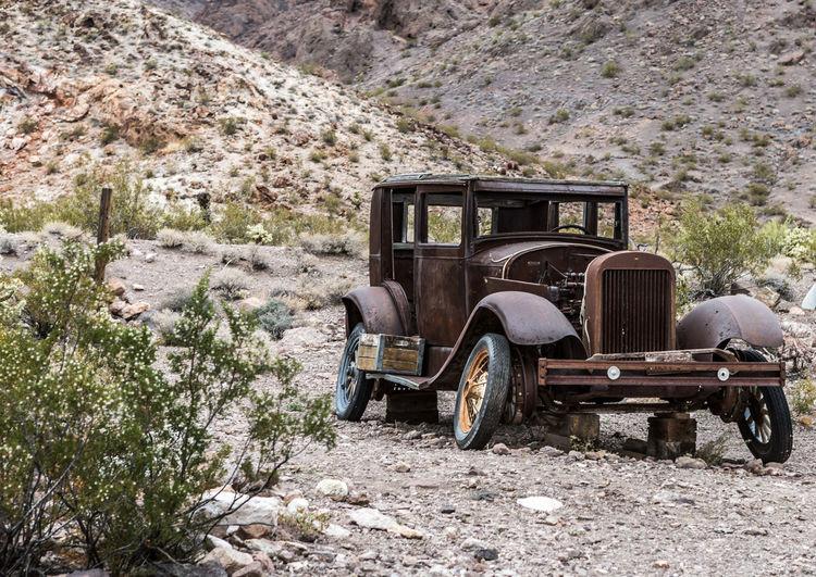 Abandoned truck on field