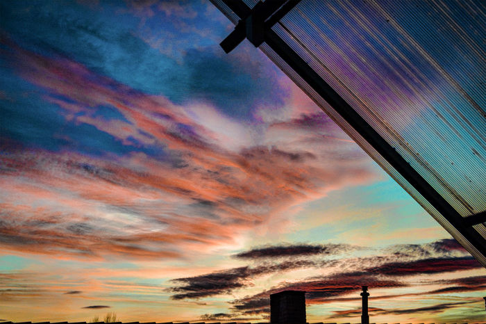 Magic coloured evening sky thru polycarbonate roofing Architecture Cloud - Sky Dramatic Sky Magic Coloured Evening Sky Thru Polycarbonate Roof No People Outdoors Sky Sunset