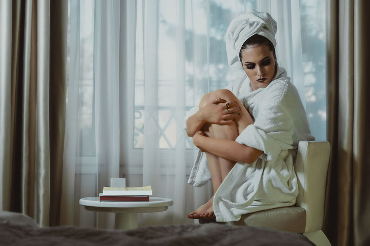 Beautiful glamorous woman in bathrobe Family Indoors  Women Emotion Sitting Togetherness Mother Window Young Real People Positive Emotion Care Girl Care Wellness Bathrobe Spa Lady Fresh Female Cosmetics Relax Therapy Pure Healthcare And Medicine