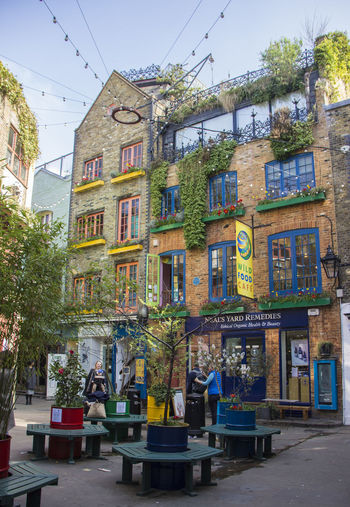 London Neal's Yard Architecture Building Building Exterior Built Structure Business Cafe City Day Food And Drink Incidental People Nature Outdoors Plant Residential District Seat Sky Street Table Tree