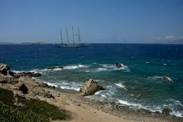 seascape with a sailing ship in a blue sea of Mykonos Sea Water Sky Horizon Land Beach Nautical Vessel Horizon Over Water Motion Transportation Rock Scenics - Nature Nature Beauty In Nature Rock - Object Sailboat Sport Solid Day No People Outdoors Sailing Ship Panorama Mykonos,Greece Seascape Sailing Cruise Summertime