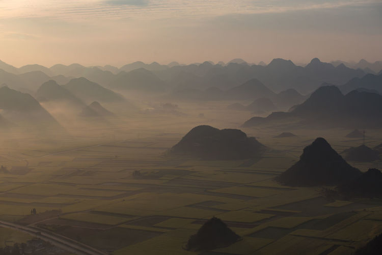 Scenics - Nature Beauty In Nature Tranquil Scene Sky Tranquility Sunset Mountain Water Nature No People Idyllic Non-urban Scene Mountain Range Environment Fog Rock Landscape Solid Outdoors