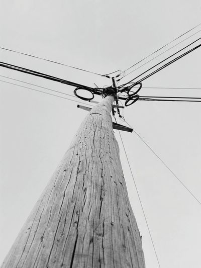 Looking up to the electric wires Technology Electricity Pylon Day Outdoors No People Wooden Post Electric Wire Black And White Black And White Collection  Black And White Photography Monochrome Photography Monochrome Wires And Cables Wires And Sky Wires Up The Sky Negative Space