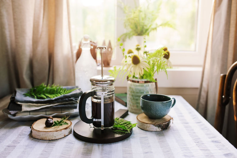 summer breakfast with french press and cup of coffee. Country living concept. House in the woods with rustic kitchen Indoors  No People Plant Day Nature Table Food Still Life Morning Breakfast Coffee Kitchen Sunlight Lifestyles Weekend Home Lazy Calm Chilling Window