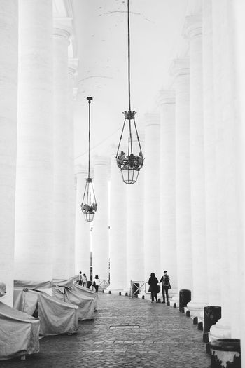 Grand Walkways With Marble Columns Surrounding The Piazza San Pietro In The Vatican City