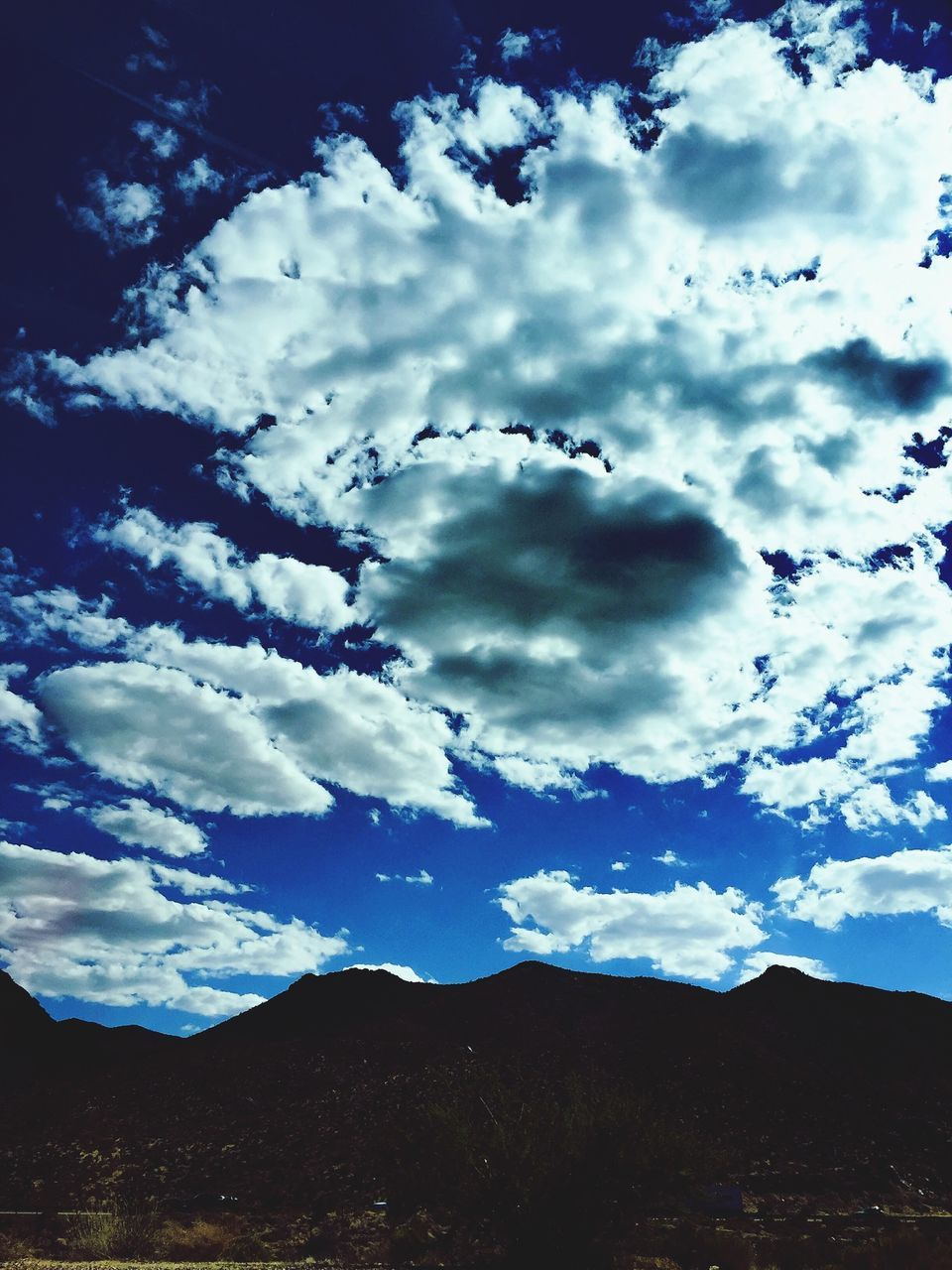 sky, cloud - sky, nature, beauty in nature, scenics, tranquility, mountain, no people, tranquil scene, day, outdoors, low angle view, landscape