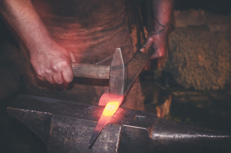 Blacksmith at work Blacksmith  Man Work Art And Craft Burning Fire Flame Forge  Glowing Hammer Hammer Out Hand Heat - Temperature Holding Human Body Part Human Hand Making Metal Industry One Person Real People Skill  Smith Smithy Working