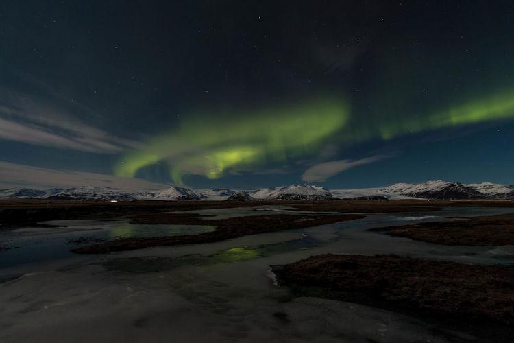 Scenic aurora borealis over vatnajokull glacier