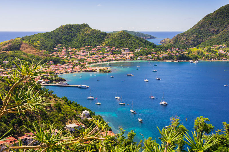 Terre-de-Haut Island, Les Saintes, Guadeloupe archipelago Terre-de-haut Les Saintes Guadeloupe Gwada  Antilles French Archipelago Island French Island Water Beauty In Nature Mountain Blue Sea Outdoors Sailboat Carribean Carribean Sea View Landscape Turquoise Water Harbor Sky Tree Palm Tree