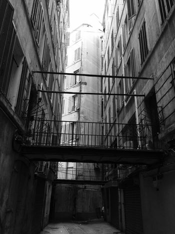 Under City Nofilter Architecture Built Structure Building Exterior Building Low Angle View No People City Residential District Day Window Outdoors Staircase Old Industry Railing Abandoned Construction Industry Steps And Staircases Fire Escape Alley