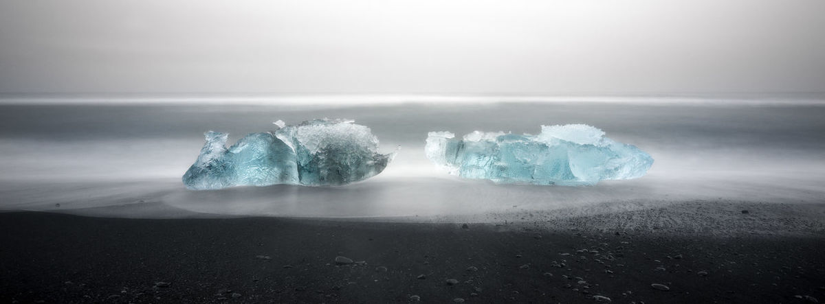 Beauty In Nature Blue Close-up Day Focus On Foreground Horizon Over Water Iceland Idyllic Jökulsárlón Nature No People Outdoors Scenics Sea Selective Focus Shore Sky Tranquil Scene Tranquility Vignette Water Landscape Two Is Better Than One Color Palette Eyeemphoto