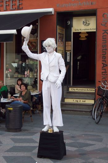 A street art performer in Copenhagen. Art Casual Clothing City City Life Day Dressed In White Full Length Hat Leisure Activity Lifestyles Monotone Outdoors Pantomime Shop Store Street Art Street Performer Tourist Attraction  White White Color