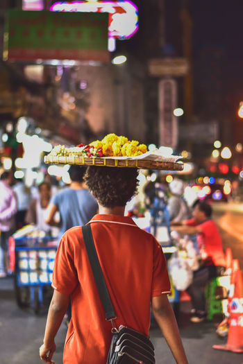 Street Architecture Night Real People Men City Rear View Market Standing Illuminated Hat Clothing Street Market Retail  Adult Lifestyles One Person Waist Up Focus On Foreground Incidental People EyeEmNewHere