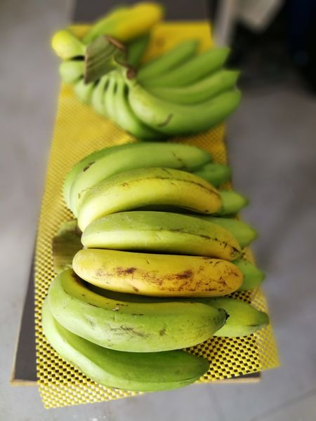 Banana Close-up Day Focus On Foreground Food Food And Drink Freshness Fruit Green Color Healthy Eating High Angle View Indoors  No People Yellow