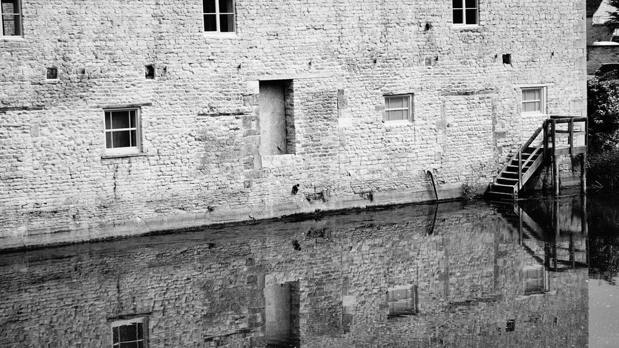 4130 Architecture Black & White Black And White Black And White Collection  Black And White Photography Black&white Blackandwhite Blackandwhite Photography Blackandwhitephotography Building Exterior Built Structure City Day No People Outdoors Reflection Reflection_collection Reflections Reflections In The Water River Riverside Water_collection Window Windows
