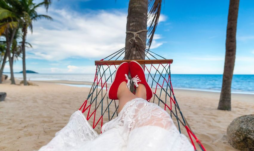 Relaxing on the beach Relaxing EyeEm Selects Sea Beach Land Sky Water Nature Horizon Sand Cloud - Sky Real People Horizon Over Water Beauty In Nature Tree One Person Vacations Day Relaxation Holiday Outdoors Hammock