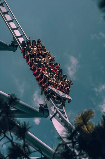 Low angle view of people in rollercoaster
