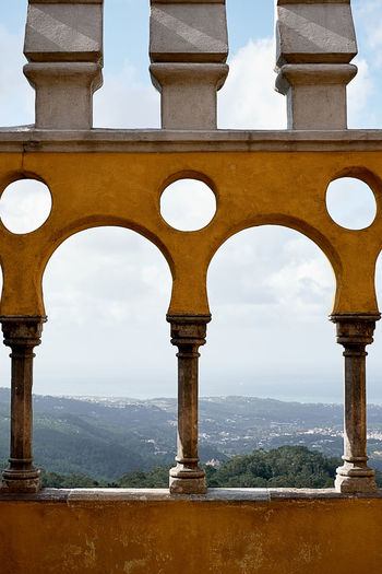 Pena palace Architecture Arch Built Structure No People Day Sky History Nature The Past Building Exterior Architectural Column Travel Destinations Outdoors Tourism Travel Cloud - Sky Building Religion Place Of Worship Old Ancient Civilization