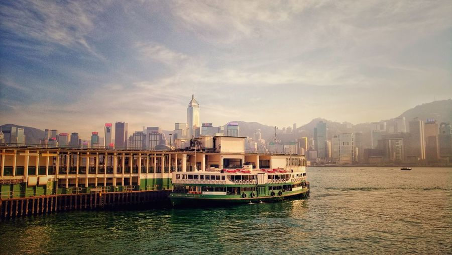 Hong Kong Cityscape and Star Ferry Cityscape Cityscape Photography Hong Kong Victoria Harbour Ferry Sea View Business Finance And Industry Architecture Skyscraper Mountain Water City Cityscape No People Outdoors Building Exterior Urban Skyline Nautical Vessel Day The Traveler - 2018 EyeEm Awards