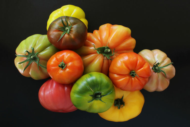High angle view of tomatoes against black background