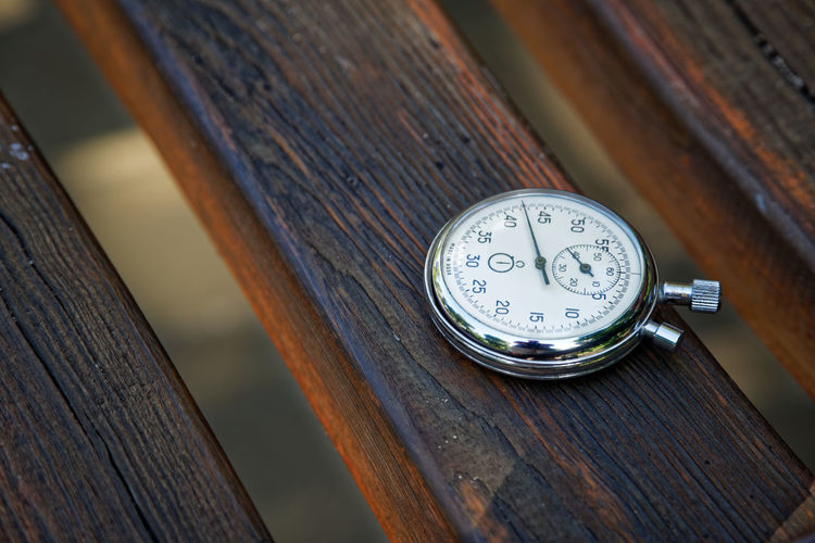 High angle view of clock on table