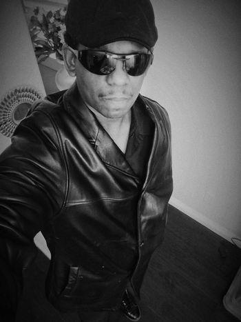 Young Men Black Jacket Power Eyeglasses  Portrait Sitting Sunglasses Serious Waist Up Close-up