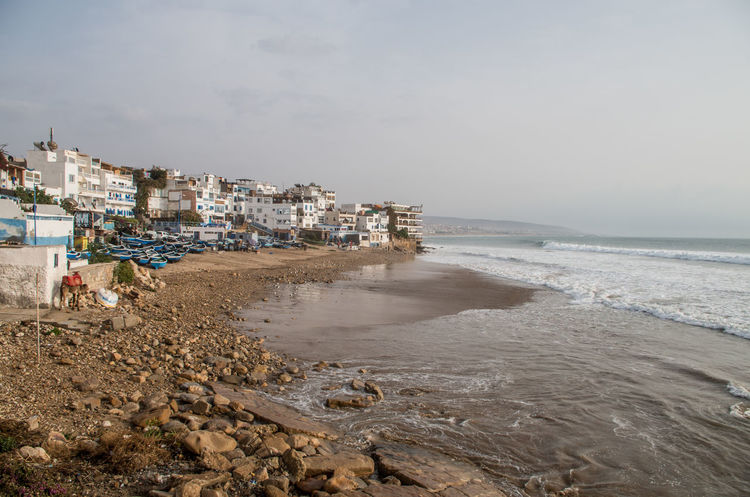 Morocco MoroccoTrip Surf Surf's Up Surfer Taghazout Beach Wave Africa Architecture Beach Building Exterior Built Structure City Day Nature No People Outdoors Sand Sea Sky Surfing Taghazout Taghazout Surfing Travel Destinations Water
