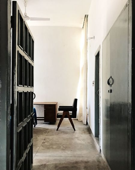Chandigarh Desk Interior Style Sunlight Architecture Bedroom Building Built Structure Chair Day Door Entrance Flooring Furniture Grey Color Home Interior Indoors  Interior Interior Design No People Seat Sunlight, Shades And Shadows Table Wall - Building Feature Wood - Material
