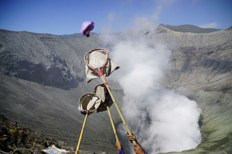 Offering falling in bird catching net during kasada festival at mt bromo