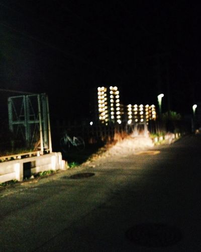 Empty walkway at night