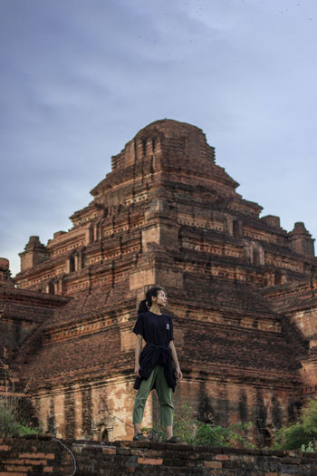 A girl in action Adult Ancient Ancient Civilization Archaeology Architecture Building Exterior Built Structure Day Full Length History Leisure Activity Low Angle View Nature One Person Rear View Ruined Sky Standing The Past Tourism Travel Travel Destinations