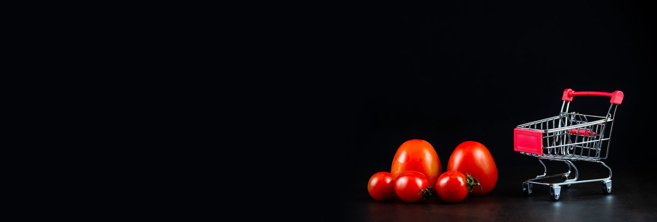 Close-up of red bell against black background