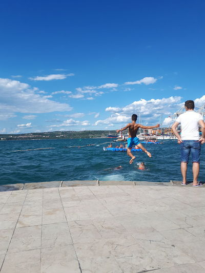 No fear EyeEm Best Shots Friends Friendship. ♡   Jump Slovenia Slovenia Seaside Action Shot  Beach Blue Child Childhood Cloud - Sky Floating On Water Friendship Jump In The Water  Jumping Koper Leisure Activity Lifestyles Observing Playing Real People Sea Sky Water The Street Photographer - 2018 EyeEm Awards The Traveler - 2018 EyeEm Awards