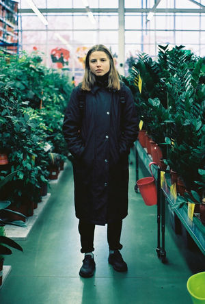 35mm Film Analogue Photography Film Ishootfilm Melancholic Analog Beautiful Woman Film Photography Filmisnotdead Floral Front View Greenhouse Indoors  Lifestyles Looking At Camera People Plant Portrait Real People Shop Standing Store Young Adult Young Woman Young Women