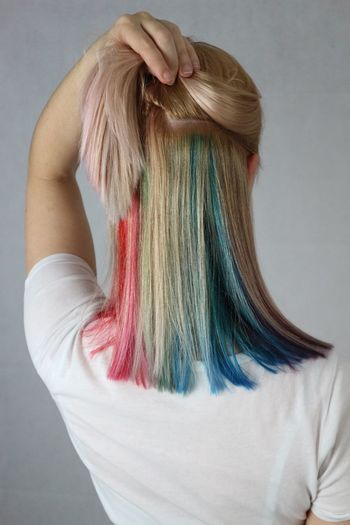 Rear View Of Woman With Dyed Hair Against Gray Background
