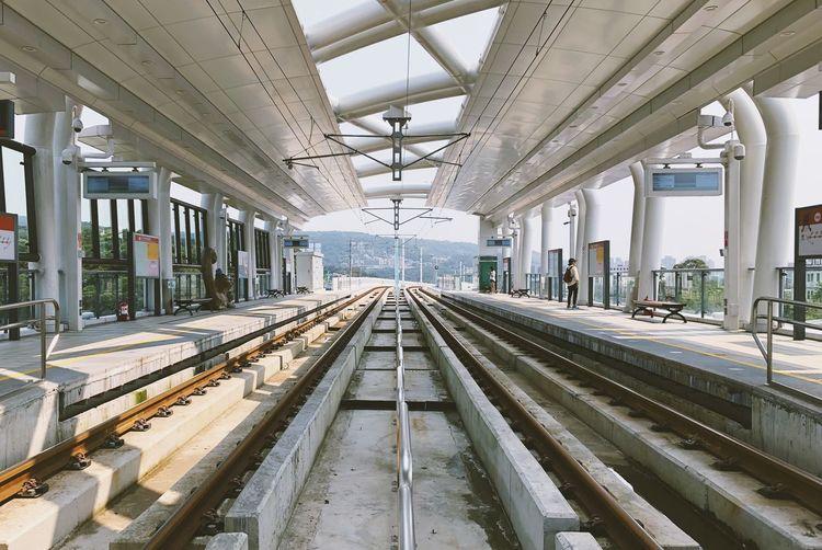 Man standing on railroad platform
