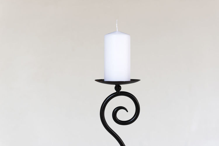 cast iron candle holder with white candle Black Candle Candle Holder Candle Stand Cast Iron Close-up Copy Space Cut Out Lighting Equipment Metal