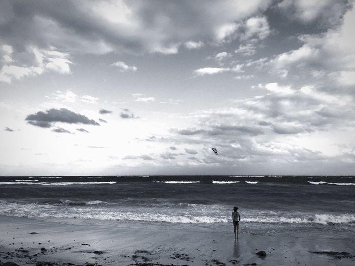 Rear View Of Woman On Sandy Beach