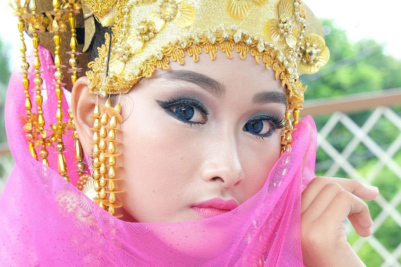 Portrait of young woman in traditional indonesian clothing