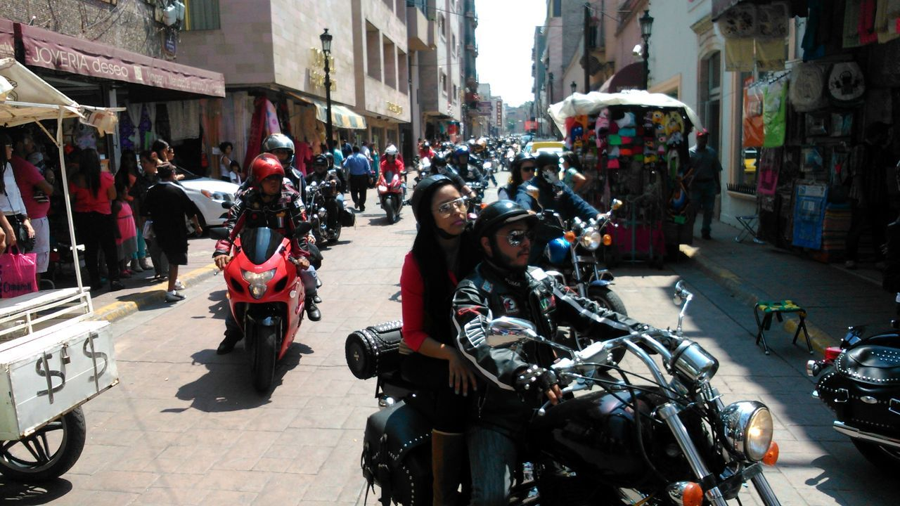 real people, motorcycle, built structure, building exterior, architecture, land vehicle, mode of transport, large group of people, transportation, street, men, incidental people, helmet, city life, day, riding, crash helmet, city, outdoors, scooter, people