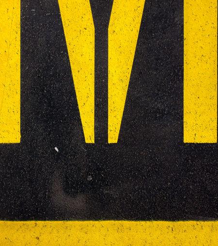 Arrow Symbol Asphalt Black Color City Communication Crosswalk Direction Dividing Line Guidance High Angle View Marking No People Outdoors Road Road Marking Sign Street Striped Symbol Transportation Warning Sign Yellow