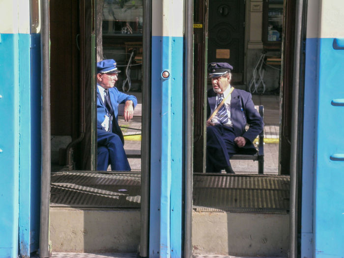 Blue Cup Eyeemphoto Leisure Activity Life Window Rest Time Tram Two Men Two Men At Work Two Men Chatting Two Men Sitting Outside Two Is Better Than One People And Places Couple Enjoy The New Normal Embrace Urban Life Framed My Year My View Finding New Frontiers