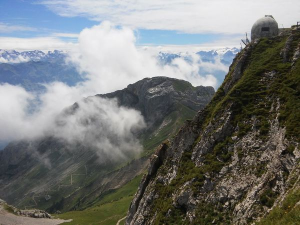 Pilatus mountain, Switzerland Mountain Cloud - Sky Outdoors Nature Day Sky Scenics Landscape Beauty In Nature Architecture Building Exterior Switzerland Vacations Pilatus Mt. Switzerland Alps Nature Travel Destinations Built Structure