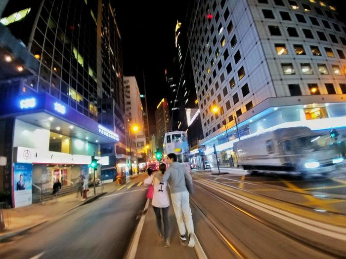 Couples in the city. By LG X20. Love Couple Night City Street Illuminated Blurred Motion City Life City Street People Road Outdoors